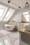 Freestanding bath in marble bathroom