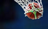Basketball ball goes through the basket, net
