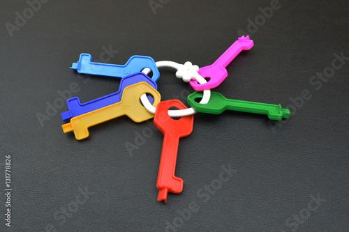 Poszter Collection of plastic keys on dark background