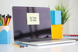 Get Your Flu Shot sticky note pasted on the laptop