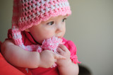 little girl in pink knitted hat