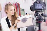 Fashion vlogger presenting woman