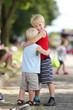 Young Brothers Hug at Parade