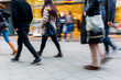 people walking on shopping street with motion blur - 131858867