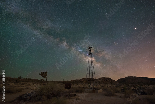 Plagát Milky Way Galaxy rising behind an old windmill