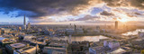 London, England - Panoramic skyline view of south London at sunset with famous skyscrapers and dark clouds over the city