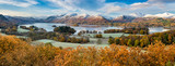 Beautiful view of Derwentwater in the English Lake District on a frosty Autumn morning with snow on the fells. - 131883607