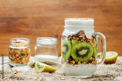 Greek yogurt granola kiwi breakfast in jar