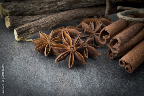 Poster Star anise,cinnamon and licorice on grey background