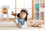 Child boy playing with toy airplane and dreaming of becoming a pilot - 131907679