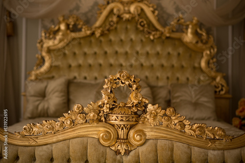 Beautiful royal and classical living room interior with a large bed in expensive apartment Poster