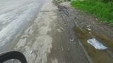 Bicicling on old city asphalt roads after rain
