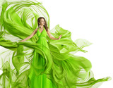 Fashion Woman Flying Dress, Model in Green Gown Waving Fabric, Flowing Chiffon Cloth Isolated over White