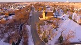 Amazing Church towers over small town USA at sunrise.