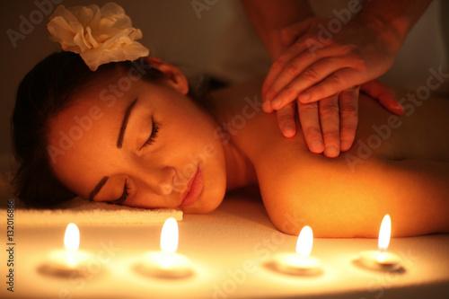 Leinwanddruck Bild Woman enjoying a massage treatment.