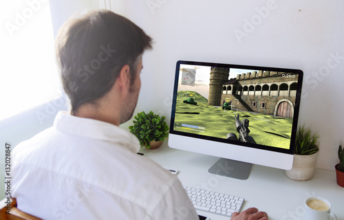man playing war videogame on computer Poster