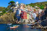 Beautiful sea village in summertime - Riomaggiore in Cinque Terre National park, Luguria, Italy.