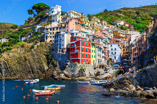 Foto op Canvas Liguria Beautiful sea village in summertime - Riomaggiore in Cinque Terre National park, Luguria, Italy.
