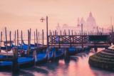 Venice, Italy. View of gondolas and Santa Maria cathedral.
