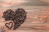 Fototapety Coffee beans, grain two hearts on background of wooden , bagging. Valentine's Day or Wedding, love, black, frame. Big and small heart