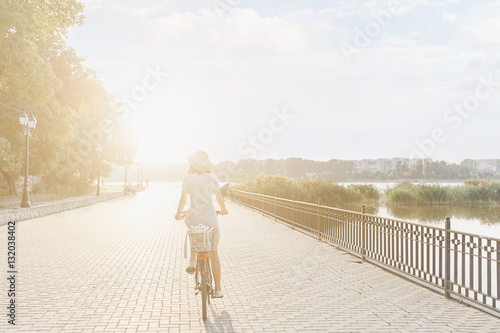 Poster Young woman against nature background with bike