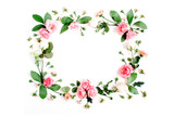 Round frame made of pink and beige roses, green leaves, branches on white background. Flat lay, top view. Valentine's background - 132040256