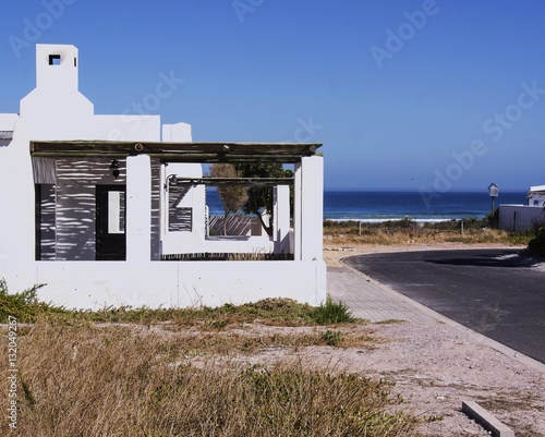 old white Portuguese or Greek houses on the beach