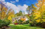 Suburban home in autumn sunshine - 132070421