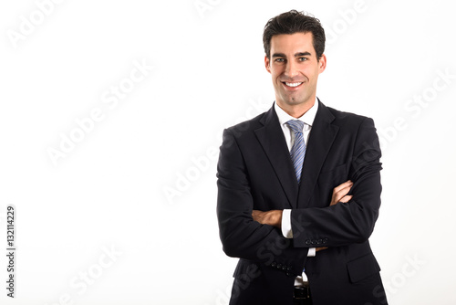 Businessman wearing blue suit and tie on white background.