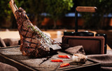 Big meat steak and vegetables lying on a table