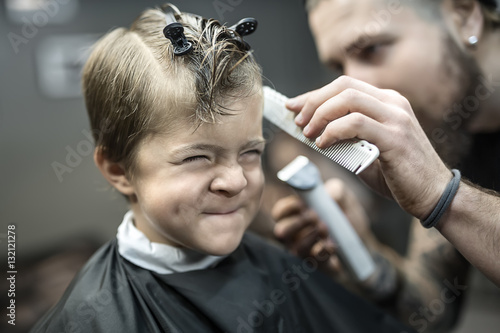 Small kid in barbershop Poster