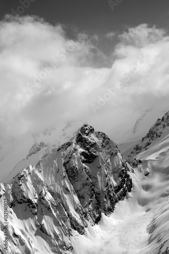 Black and white view on snow mountains in cloud - 132140875