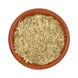 Bowl of oatstraw herb on a white background top view.