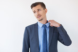 Tired Middle-aged Business Man Pulling Collar