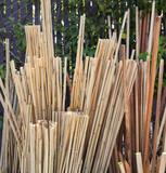 Bin full of bamboo garden stakes. Vertical.