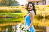 Beautiful young bridesmaid with curly hair