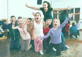 Cheerful children  in dance studio having fun