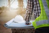 engineer working on building site - 132174489