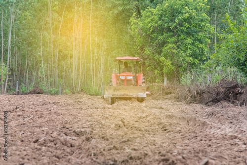Poster Farmer in tractor preparing land with seed cultivator as part of pre seeding act