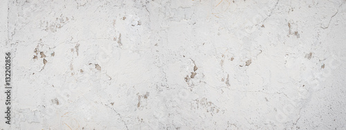 Poster Grey abstract textured background cracked plaster. Texture of gray cracked paint wall. Background Plaster Wall Texture Gray