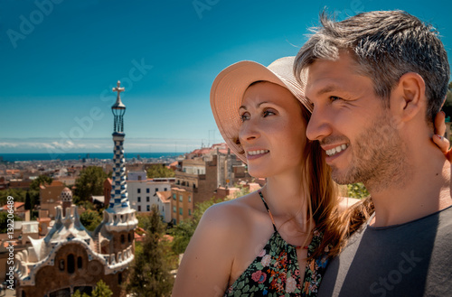 Travel couple in Park Guell in Barcelona Poster