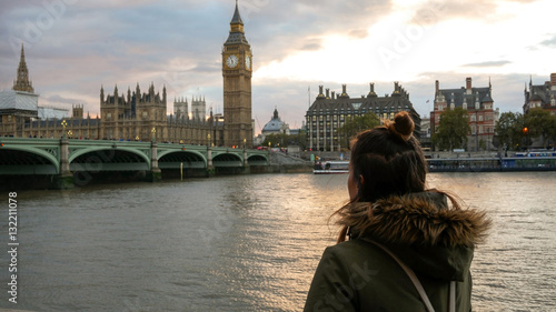 Woman looking at Westminster palace
