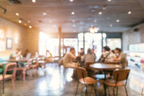 Naklejka Blur coffee shop or cafe restaurant with abstract bokeh light im