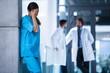 Detaily fotografie Stressed nurse standing in hospital