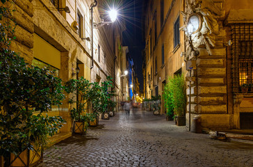 Night view of old cozy street in Rome, Italy