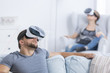 Detaily fotografie People focused on VR goggles