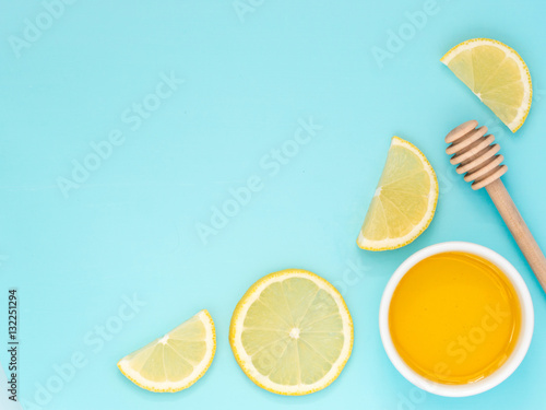 Poster Lemon and honey on blue with copy space