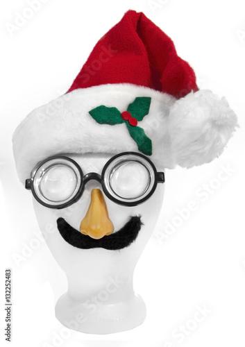 Poster Goofy Santa face: cap,nerd glasses, nose, and mustache on styrofoam mannequin head