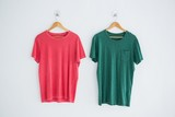 Pink and green t-shirts hanging on hanger