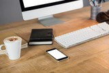 Desktop pc and smartphone with cup of coffee